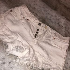 Free People Distressed from and back Denim shorts